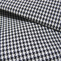Harper Houndstooth Black/White Upholstery Fabric by Roth and Tompkins